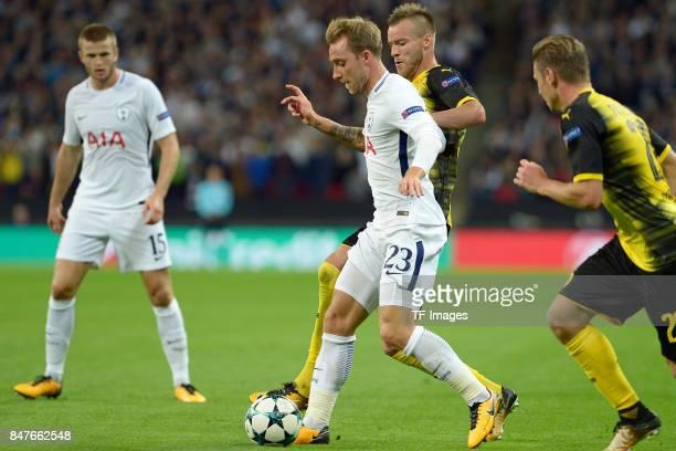 Christian Eriksen of Tottenham and Andrey Yarmolenko of Dortmund battle for the ball during the UEFA Champions League group H match between Tottenham...
