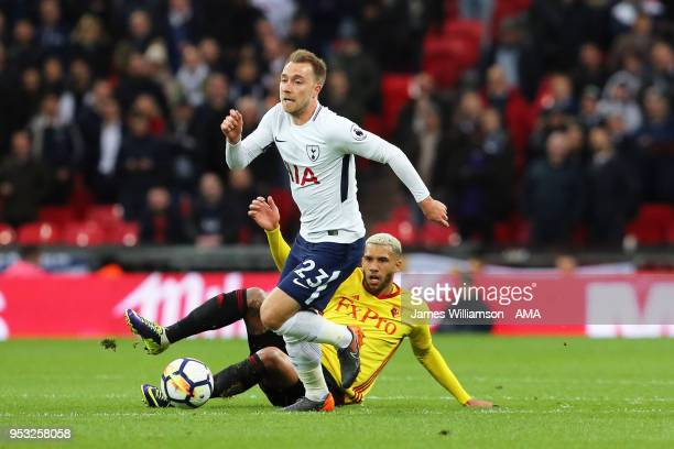 Christian Eriksen of Tottenham and Etienne Capoue of Watford during the Premier League match between Tottenham Hotspur and Watford at Wembley Stadium...