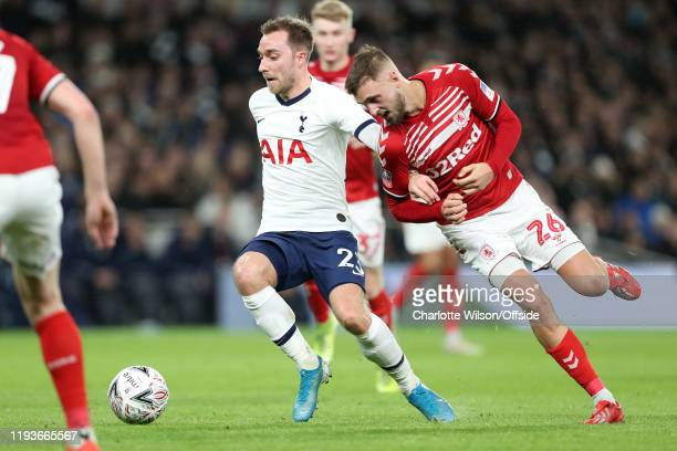 Christian Eriksen of Tottenham and Lewis Wing of Middlesbrough during the FA Cup Third Round Replay match between Tottenham Hotspur and Middlesbrough...