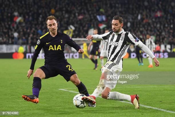 Christian Eriksen of Tottenham battles Mattia De Sciglio of Juventus during the UEFA Champions League Round of 16 First Leg match between Juventus...