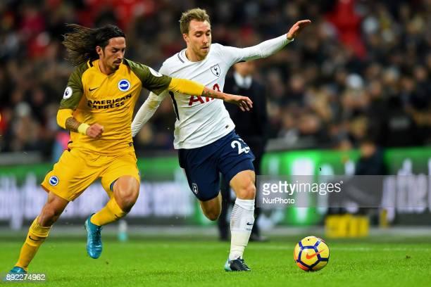 Christian Eriksen of Tottenham battles with Brighton and Hove Albion defender Ezequiel Schelotto during Premier League match between Tottenham...