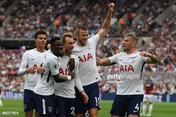 Christian Eriksen of Tottenham celebrates with team mates after scoring his team's third goal during the Premier League match between West Ham United...