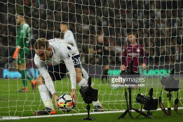 Christian Eriksen of Tottenham grabs the ball after scores a goal to make it 12 during the Premier League match between Tottenham Hotspur and...