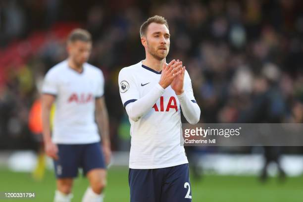 Christian Eriksen of Tottenham Hotspur acknowledges the fans at fulltime during the Premier League match between Watford FC and Tottenham Hotspur at...
