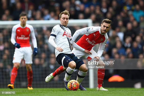 Christian Eriksen of Tottenham Hotspur and Aaron Ramsey of Arsenal compete for the ball during the Barclays Premier League match between Tottenham...