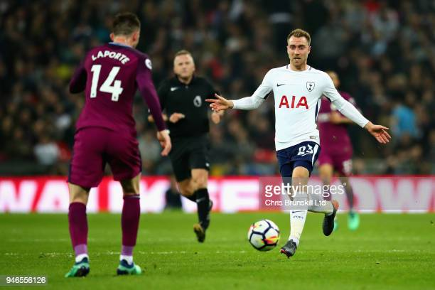 Christian Eriksen of Tottenham Hotspur and Aymeric Laporte of Manchester City in action during the Premier League match between Tottenham Hotspur and...