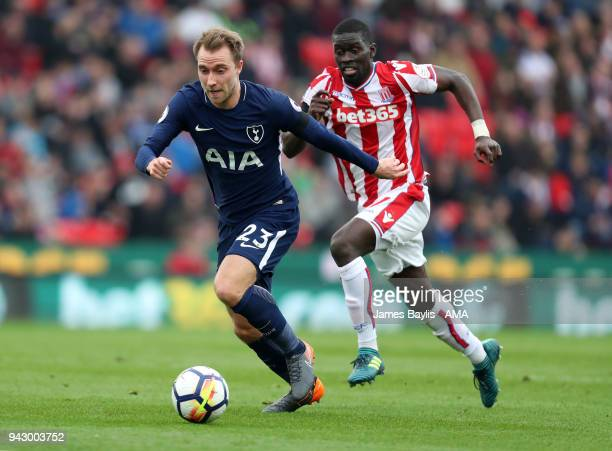 Christian Eriksen of Tottenham Hotspur and Badou Ndiaye of Stoke City during the Premier League match between Stoke City and Tottenham Hotspur at...