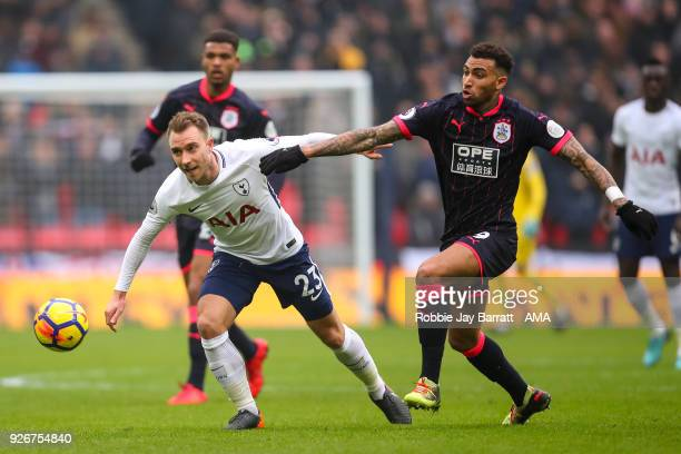 Christian Eriksen of Tottenham Hotspur and Daniel Williams of Huddersfield Town during the Premier League match between Tottenham Hotspur and...