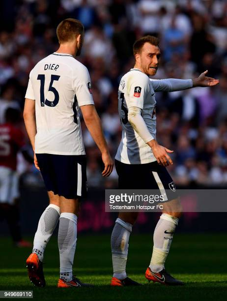Christian Eriksen of Tottenham Hotspur and Eric Dier of Tottenham Hotspur react during The Emirates FA Cup Semi Final between Manchester United and...