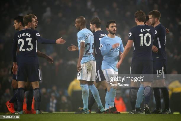 Christian Eriksen of Tottenham Hotspur and Fernandinho of Manchester City shake hands after the Premier League match between Manchester City and...