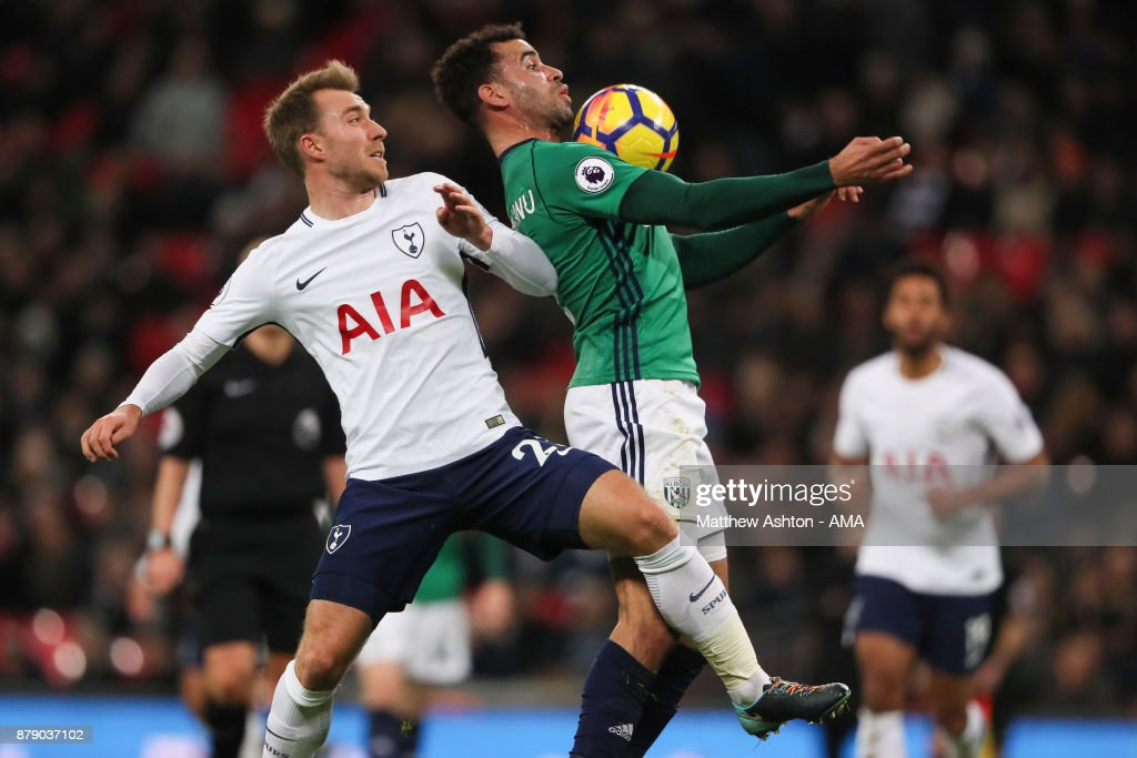 Christian Eriksen of Tottenham Hotspur and Hal Robson-Kanu of West Bromwich Albion during the Premier League match between Tottenham Hotspur and West Bromwich Albion at Wembley Stadium on November 25, 2017 in London, England.