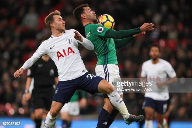 Christian Eriksen of Tottenham Hotspur and Hal RobsonKanu of West Bromwich Albion during the Premier League match between Tottenham Hotspur and West...
