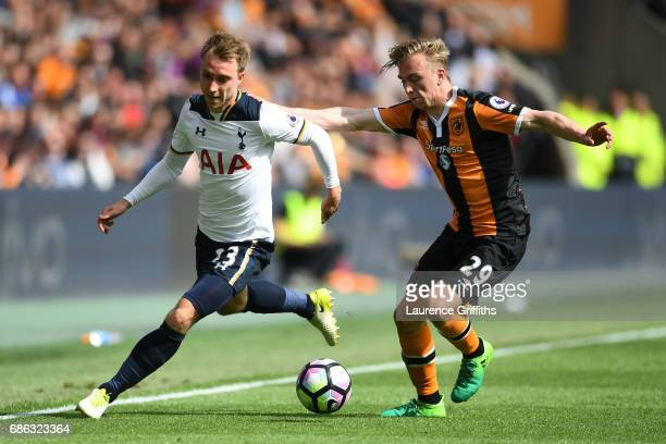 Christian Eriksen of Tottenham Hotspur and Jarrod Bowen of Hull City battle for the ball during the Premier League match between Hull City and...