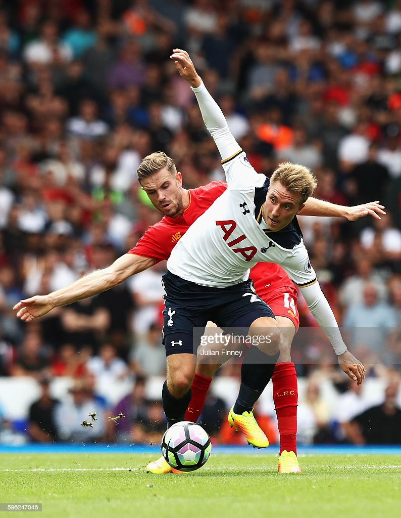 Christian Eriksen of Tottenham Hotspur (F) and Jordan Henderson of Liverpool (R) battle for possession during the Premier League match between Tottenham Hotspur and Liverpool at White Hart Lane on August 27, 2016 in London, England.