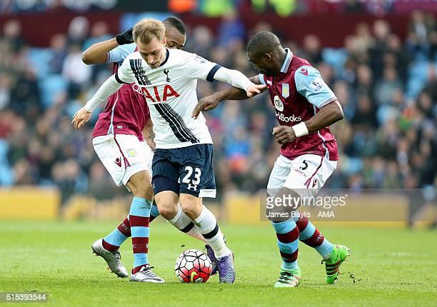 Christian Eriksen of Tottenham Hotspur and Jores Okore of Aston Villa during the Barclays Premier League match between Aston Villa and Tottenham...
