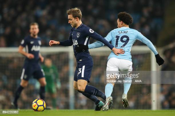 Christian Eriksen of Tottenham Hotspur and Leroy Sane of Manchester City during the Premier League match between Manchester City and Tottenham...