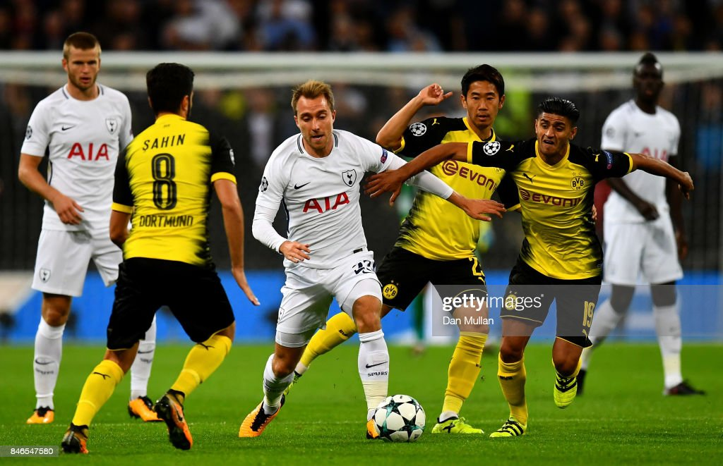 Christian Eriksen of Tottenham Hotspur and Shinji Kagawa of Borussia Dortmund battle for possession during the UEFA Champions League group H match between Tottenham Hotspur and Borussia Dortmund at Wembley Stadium on September 13, 2017 in London, United Kingdom.