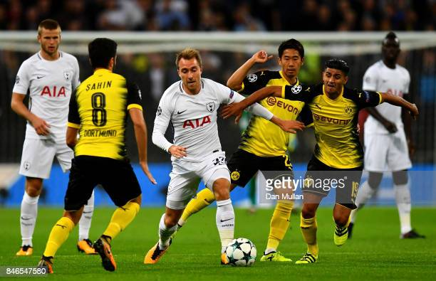 Christian Eriksen of Tottenham Hotspur and Shinji Kagawa of Borussia Dortmund battle for possession during the UEFA Champions League group H match...