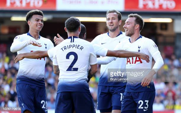 Christian Eriksen of Tottenham Hotspur and team mates celebrate as Abdoulaye Doucoure of Watford scores an own goal for their first goal during the...