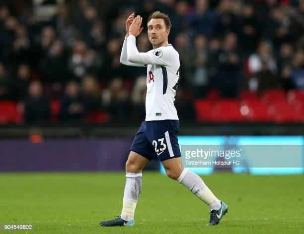 Christian Eriksen of Tottenham Hotspur applauds the crowd during the Premier League match between Tottenham Hotspur and Everton at Wembley Stadium on...