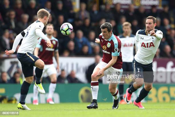 Christian Eriksen of Tottenham Hotspur attempts to contorl the ball while under pressure from Joey Barton of Burnley during the Premier League match...