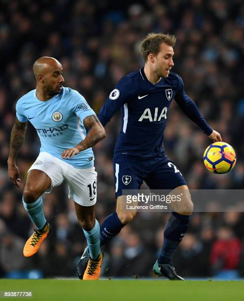 Christian Eriksen of Tottenham Hotspur battles for possesion with with Fabian Delph of Manchester City during the Premier League match between...