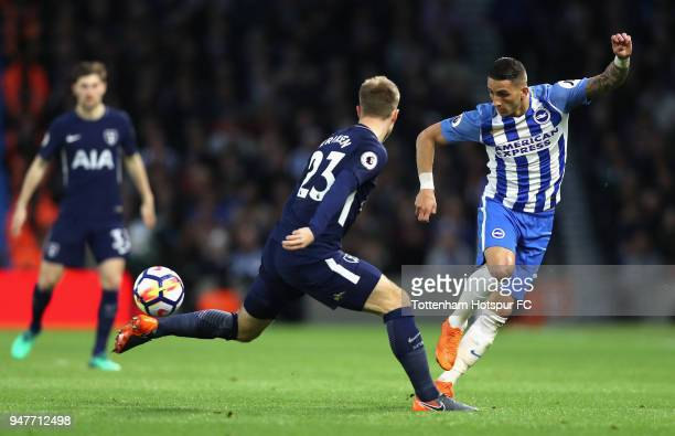 Christian Eriksen of Tottenham Hotspur battles for possesion with Anthony Knockaert of Brighton and Hove Albion during the Premier League match...