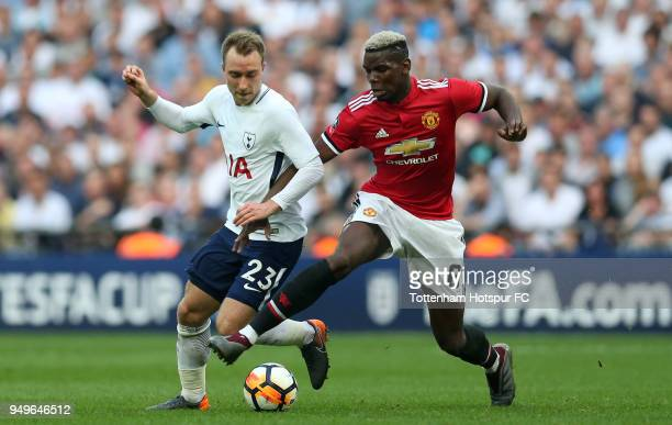 Christian Eriksen of Tottenham Hotspur battles for possesion with Paul Pogba of Manchester United during The Emirates FA Cup Semi Final match between...