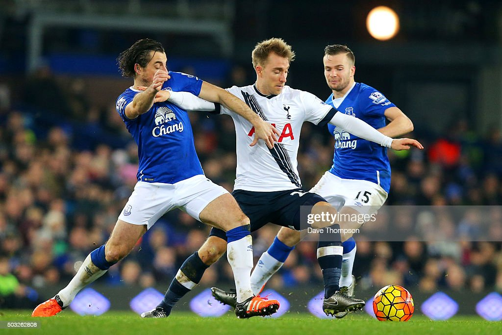Christian Eriksen of Tottenham Hotspur battles for the ball with Leighton Baines and Tom Cleverley of Everton during the Barclays Premier League match between Everton and Tottenham Hotspur at Goodison Park on January 3, 2016 in Liverpool, England.