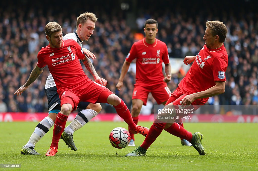 Christian Eriksen of Tottenham Hotspur battles with Alberto Moreno and Lucas Leiva of Liverpool as Philippe Coutinho looks on during the Barclays Premier League match between Tottenham Hotspur and Liverpool at White Hart Lane on October 17, 2015 in London, England.