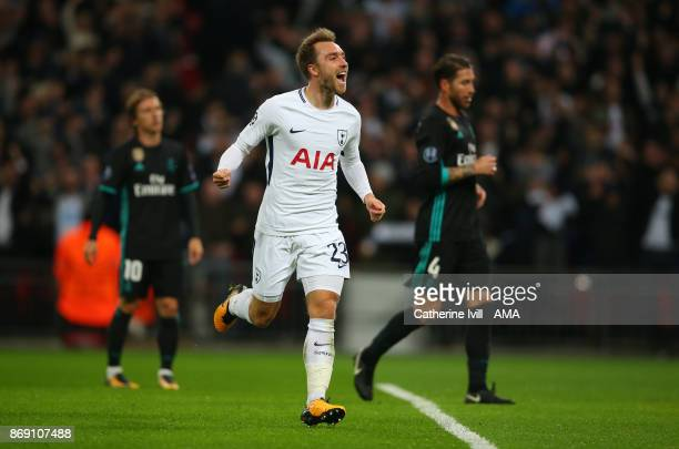 Christian Eriksen of Tottenham Hotspur celebrates after he scores a goal to make it 30 during the UEFA Champions League group H match between...