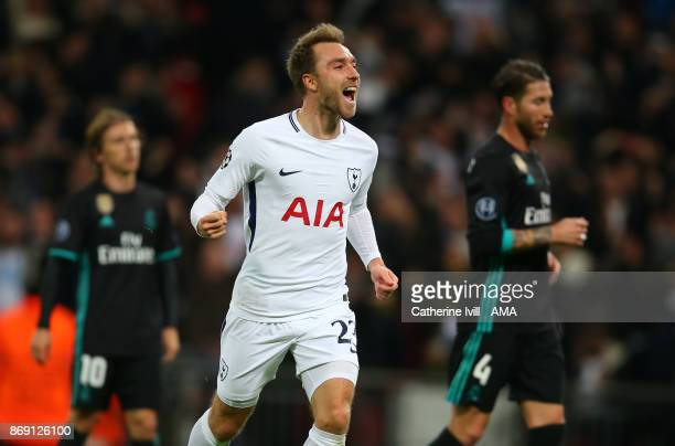 Christian Eriksen of Tottenham Hotspur celebrates after he scores a goal to make it 31 during the UEFA Champions League group H match between...