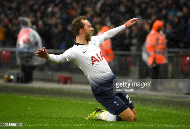 Christian Eriksen of Tottenham Hotspur celebrates after scoring his team's first goal during the Premier League match between Tottenham Hotspur and...