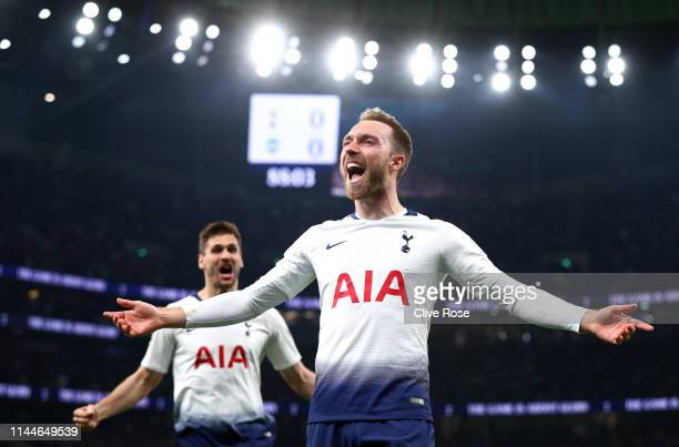 Christian Eriksen of Tottenham Hotspur celebrates after scoring his team's first goal during the Premier League match between Tottenham Hotspur and...