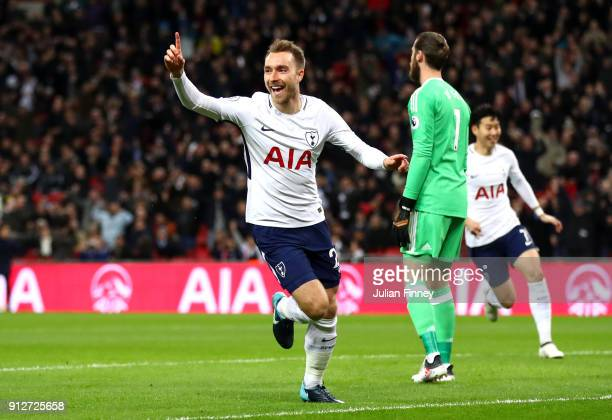 Christian Eriksen of Tottenham Hotspur celebrates after scoring his sides first goal during the Premier League match between Tottenham Hotspur and...