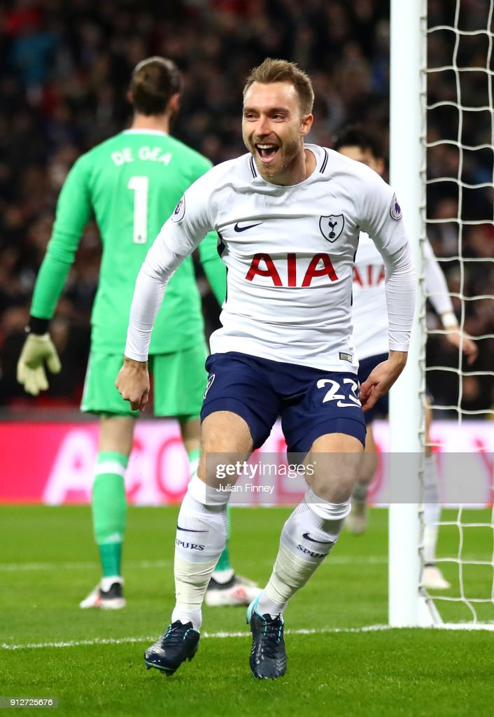Christian Eriksen of Tottenham Hotspur celebrates after scoring his sides first goal during the Premier League match between Tottenham Hotspur and Manchester United at Wembley Stadium on January 31, 2018 in London, England.