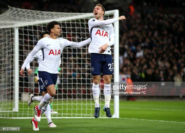 Christian Eriksen of Tottenham Hotspur celebrates after scoring his sides first goal with Dele Alli of Tottenham Hotspur during the Premier League...