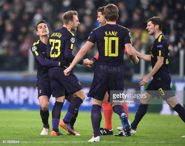 Christian Eriksen of Tottenham Hotspur celebrates after scoring his sides second goal with his team mates during the UEFA Champions League Round of...