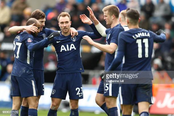 Christian Eriksen of Tottenham Hotspur celebrates after scoring his sides third goal with his team mates during The Emirates FA Cup Quarter Final...