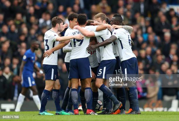 Christian Eriksen of Tottenham Hotspur celebrates after scoring his sides first goal with his team mates during the Premier League match between...