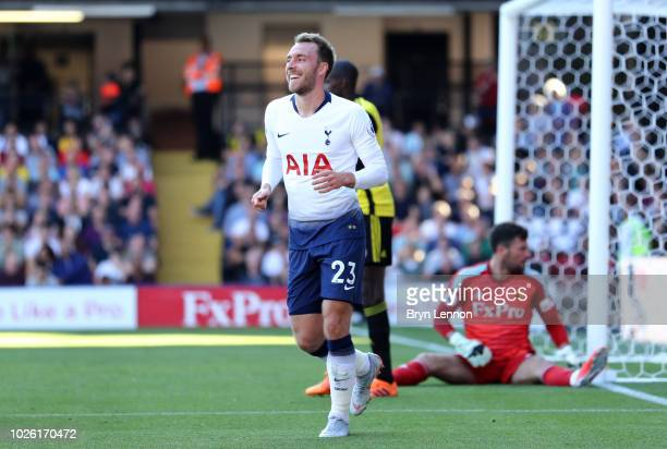 Christian Eriksen of Tottenham Hotspur celebrates as Abdoulaye Doucoure of Watford scores an own goal for their first goal during the Premier League...
