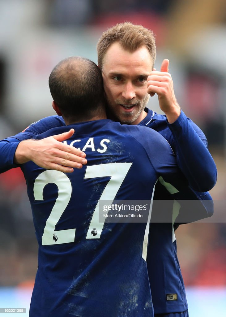 Christian Eriksen of Tottenham Hotspur celebrates scoring his 2nd goal with Lucas Moura during the Emirates FA Cup Quarter Final match between Swansea City and Tottenham Hotspur at Liberty Stadium on March 17, 2018 in Swansea, Wales.