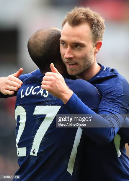 Christian Eriksen of Tottenham Hotspur celebrates scoring his 2nd goal with Lucas Moura during the Emirates FA Cup Quarter Final match between...
