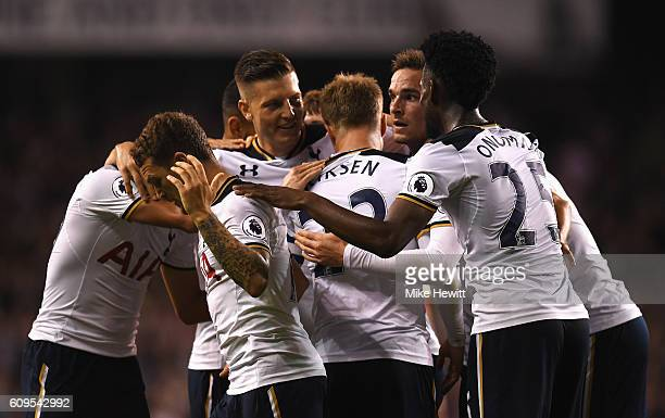 Christian Eriksen of Tottenham Hotspur celebrates scoring his sides first goal with team mates during the EFL Cup Third Round match between Tottenham...