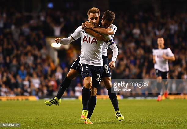 Christian Eriksen of Tottenham Hotspur celebrates scoring his sides first goal with Harry Winks of Tottenham Hotspur during the EFL Cup Third Round...
