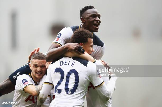 Christian Eriksen of Tottenham Hotspur celebrates scoring his sides first goal and his mobbed by Victor Wanyama of Tottenham Hotspur and team mates...