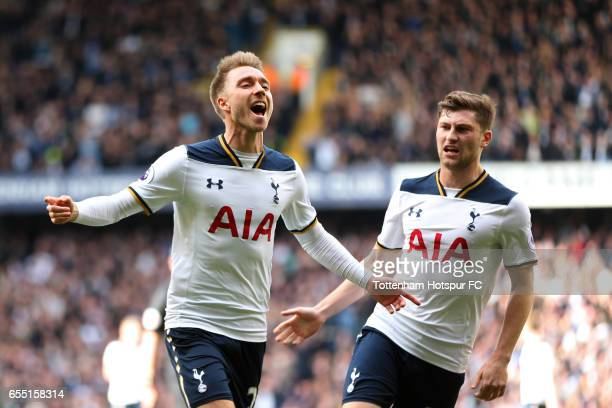 Christian Eriksen of Tottenham Hotspur celebrates scoring his sides first goal with Ben Davies of Tottenham Hotspur during the Premier League match...