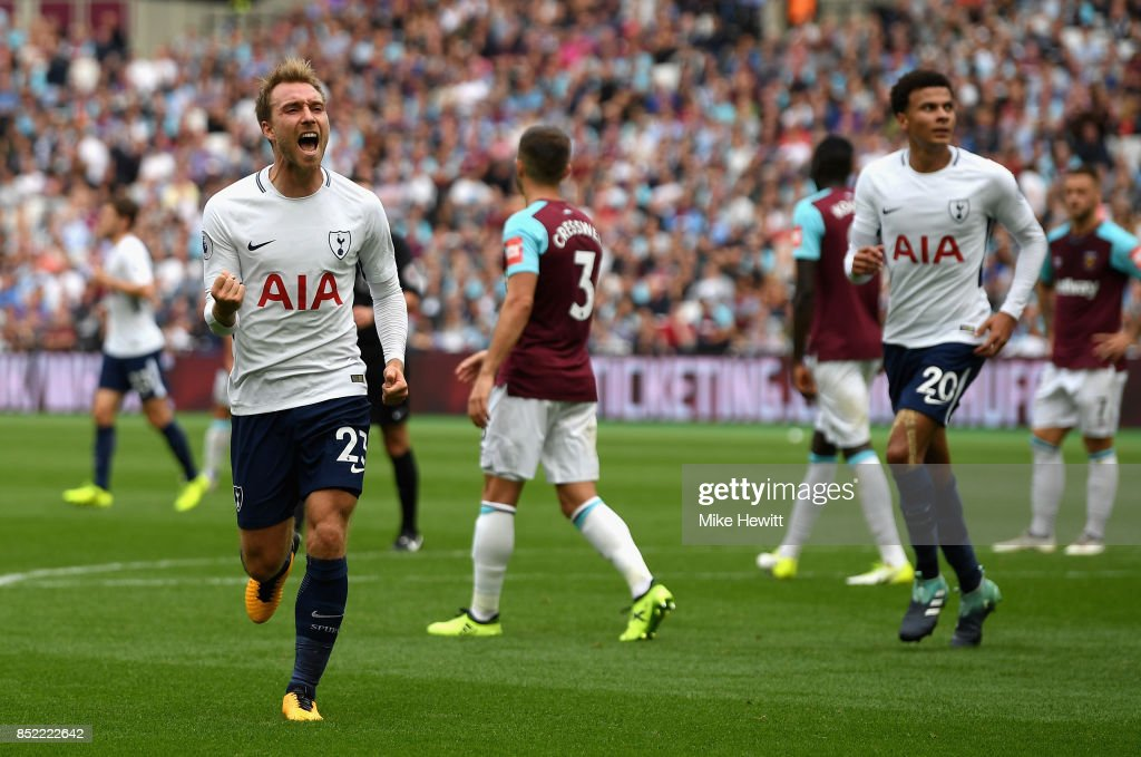 Christian Eriksen of Tottenham Hotspur celebrates scoring his sides third goal during the Premier League match between West Ham United and Tottenham Hotspur at London Stadium on September 23, 2017 in London, England.