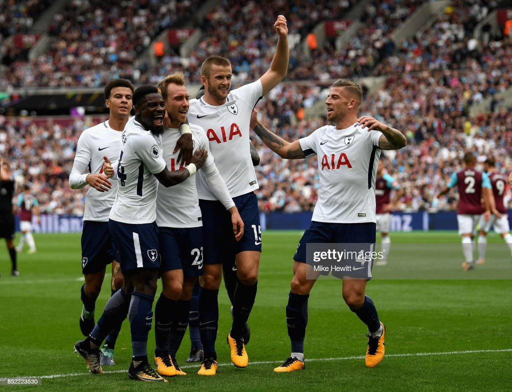 Christian Eriksen of Tottenham Hotspur celebrates scoring his sides third goal with his Tottenham Hotspur team mates during the Premier League match between West Ham United and Tottenham Hotspur at London Stadium on September 23, 2017 in London, England.