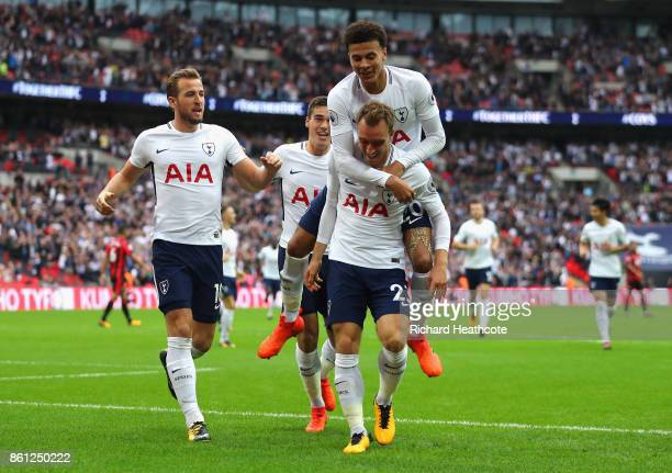 Christian Eriksen of Tottenham Hotspur celebrates scoring his sides first goal with his Tottenham Hotspur team mates during the Premier League match...